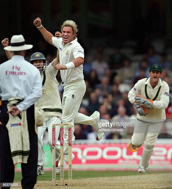Australia's spin bowler Shane Warne jumps in the air after claiming the opening wicket of England's Andrew Strauss during their 2nd innings during...