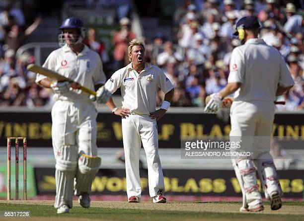 Australia's spin bowler Shane Warne shows his frustration as Englands Andrew Strauss and Andrew Flintoff score runs on the first day of the fifth and...
