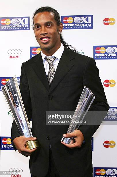 Barcelona's Brazilian football player Ronaldinho poses with his trophies after being awarded player of the year by FIFPro the international...
