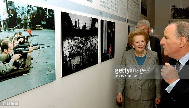 Baroness Margaret Thatcher listens to chairman of the Imperial War Museum Air Chief Marshal Sir Peter Squire after she opened the Museum's exhibition...