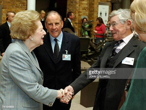 Baroness Margaret Thatcher shakes hands with former commander of the British Land Forces Falkland Islands General Sir Jeremy Moore while chairman of...