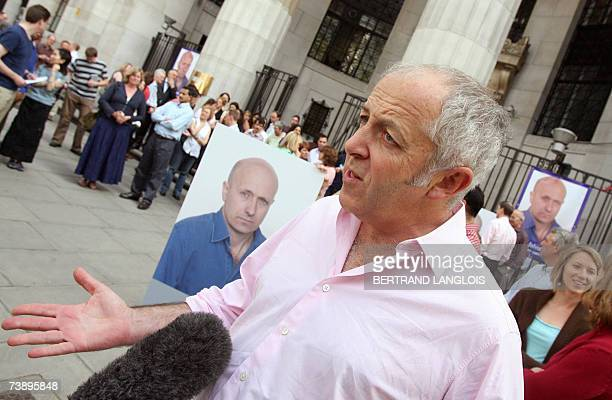 BBC journalist Jeremy Bowen joins other employees outside Bush House in central London 16 April 2007 as they gather for a silent vigil in tribute to...
