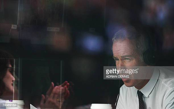 BBC television commentator and former Wimbledon champion John McEnroe is seen as Serena Williams of USA plays Daniela Hantuchova of Slovakia during...
