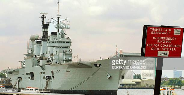 Britain's aircraft carrier HMS Ark Royal sails up the River Thames in London 13 June 2007 as it prepares to take part in a series of events to mark...