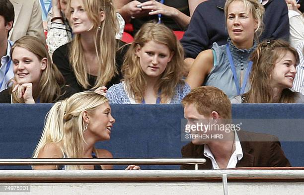 "London, UNITED KINGDOM: Britain's Prince Harry talks to his girlfriend Chelsy Davy at the ""Concert for Diana"", held in memory of his mother Princess..."