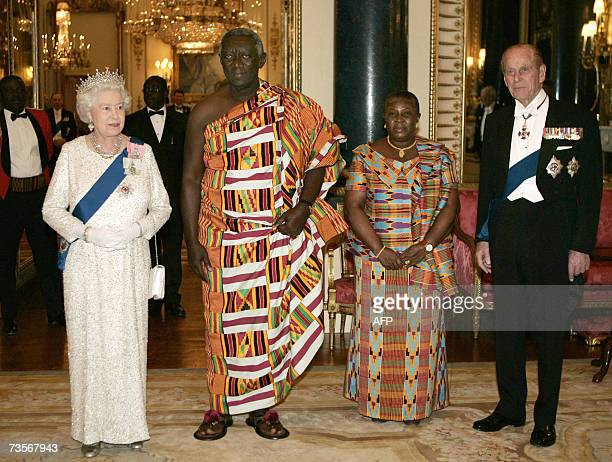 Britain's Queen Elizabeth II and her husband Prince Philip flank visiting President of Ghana John Agyekum Kufuor and his wife Theresa Kufuoras they...