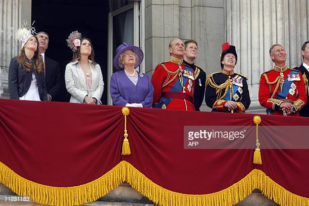 Britain's Queen Elizabeth II and her husband The Duke of Edinburgh watch the Red Arrows fly over 17 June 2006 during the traditional Trooping the...