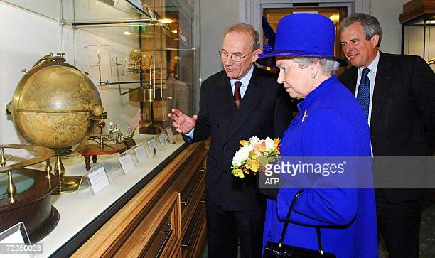 Britain's Queen Elizabeth II is shown a 1797 moon globe by John Russell which was donated to the Science Museum in 1949 by her father King George VI...