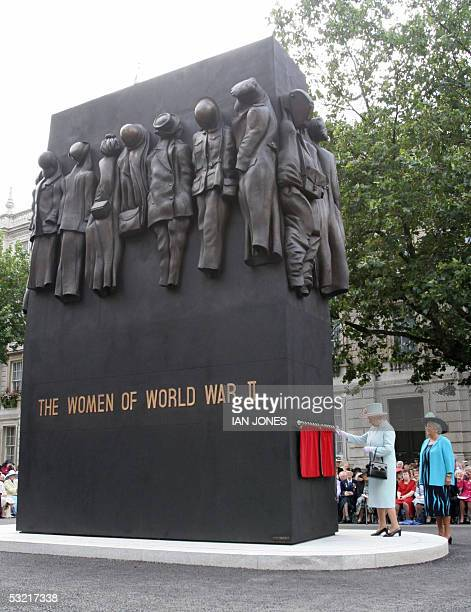 Britain's Queen Elizabeth II unveils the Women of World War II Monument Whitehal in London 09 July 2005 The courage resilience and determination of...