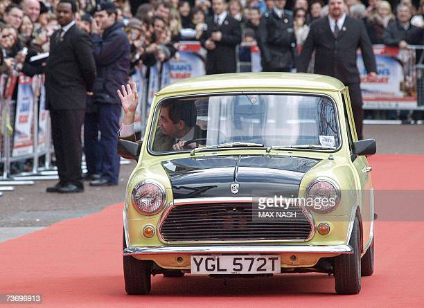 British actor Rowan Atkinson arrives on the red carpet in the Mini used in the film for the British Charity Premiere of his latest film 'Mr Bean's...