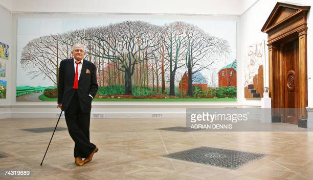 British artist David Hockney stands before his work 'Bigger Trees Near Warter or/ou Peinture en Plein Air pour l'age PostPhotographique' at The Royal...