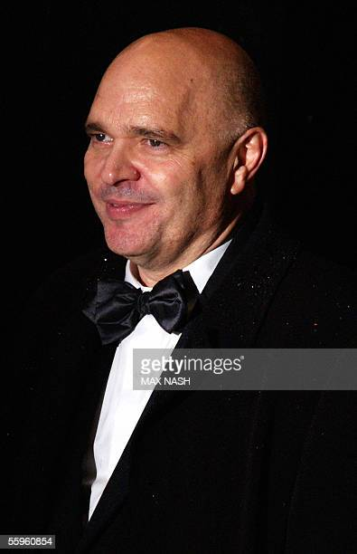 British director Anthony Minghella arrives under rain for the British Premiere of the film 'The Constant Gardener' in London's Leicester Square late...