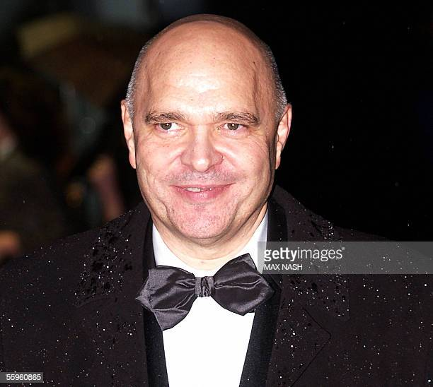British director Anthony Minghella arrives under pouring rain for the British Premiere of the film 'The Constant Gardener' in London's Leicester...
