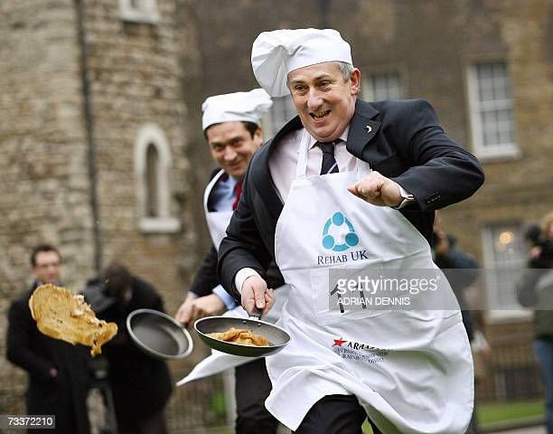 British Member of Parliament Lindsay Hoyle runs down College Green during the '2007 Parliamentary Pancake Race' in aid of charity early Shrove...