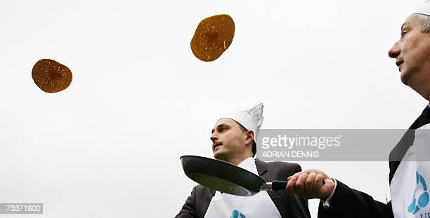 British Members of Parliament Daniel Kawczynski and Lindsay Hoyle practice tossing pancakes before the start of the '2007 Parliamentary Pancake Race'...