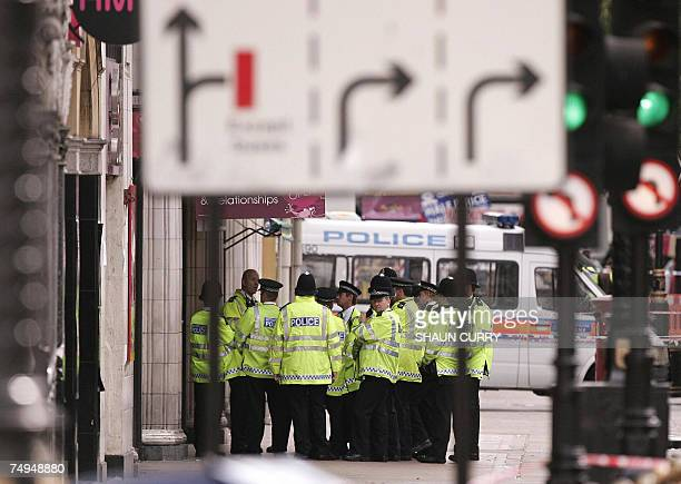British Metropolitan police officers gather in Haymarket in central London 29 June 2007 where a Mercedes car in what police said contained a...