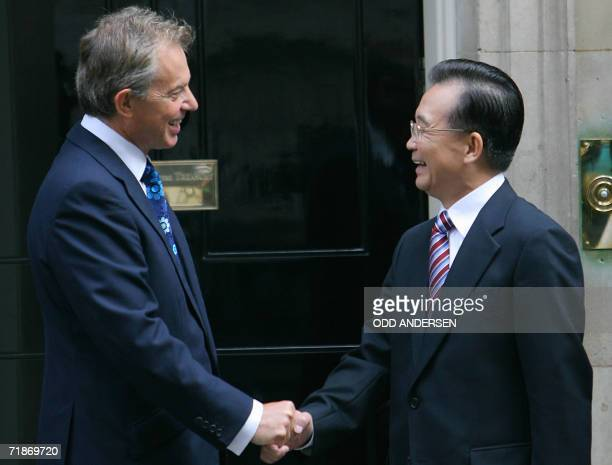 British Prime Minister Tony Blair greets his Chinese counterpart Wen Jiabao at 10 Downing Street in London 13 September 2006 AFP PHOTO / ODD ANDERSEN