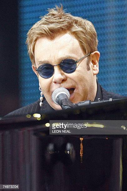 British singer Elton John performs at Wembley stadium in north London 01 July 2007 as 60000 revellers joined Princes William and Harry for the...