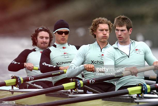 Cambridge University's American oarsman Jacob Cornelius rows with British teammate Peter Champion and Canadain pair Dan O'Shaughnessy and Kristopher...