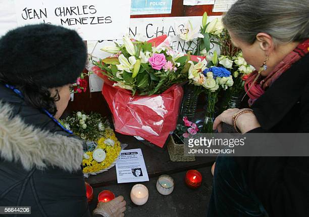 Candles are light in front of flowers at Stockwell tube station in London 22 January 2006 ahead of a vigil to mark six months since the killing of...
