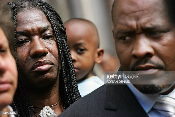 Chagos Islanders look on while Louis Olivier Bancoult Chairman of the Chagos Refugees Group addresses the media outside The High Court in central...