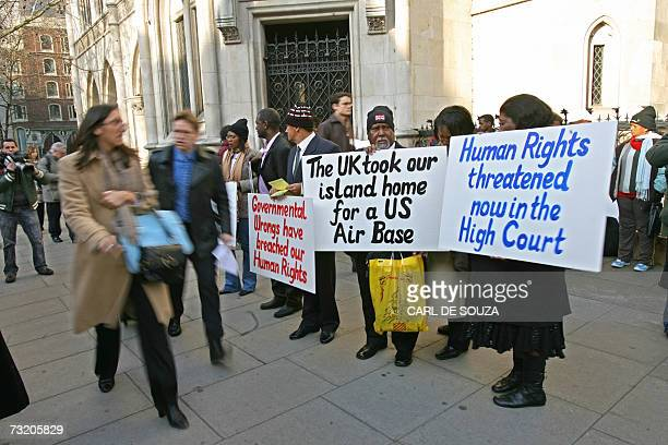Chagossian Islanders and their supporters arrive at the Court of Appeal in central London 05 February 2007 as they prepare to fight a court ruling...