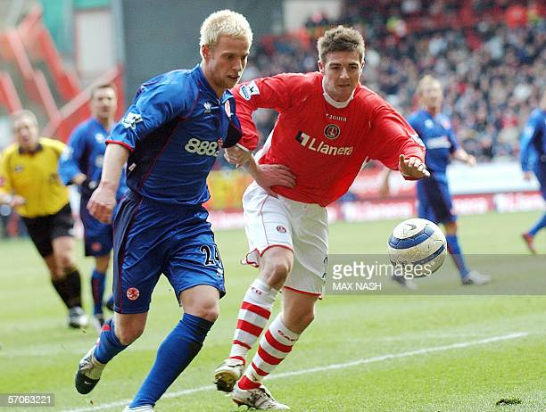 Charlton's English midfielder Bryan Hughes and Middlesbrough's Andrew Davies run for the ball during their English Premiership football match 12...