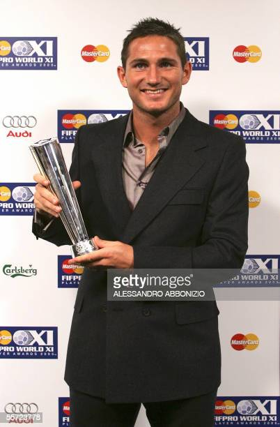 London, UNITED KINGDOM: Chelsea and England player Frank Lampard poses with his award after being nominated as one of four mid-fielders in the FIFPRO...