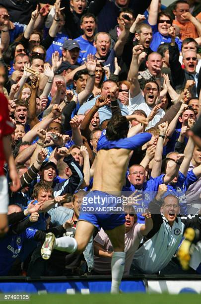 Chelsea fans acknowledge Joe Cole after his goal against Manchester United during a premiership match at Stamford Bridge in west London 29 April 2006...