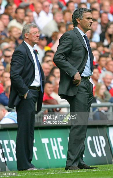 Chelsea manager Jose Mourinho and Manchester United manager Sir Alex Ferguson instruct their team's at Wembley Stadium in London 19 May 2007 during...