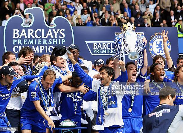 Chelsea's Captain John Terry lifts the Premiership trophy alongside teammates after defeating Manchester United to win the Premiership title at...