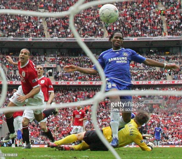 Chelsea's Didier Drogba puts the ball past Manchester United's goalkeeper Edwin Van Der Sar to win 10 at Wembley Stadium in London 19 May 2007 during...