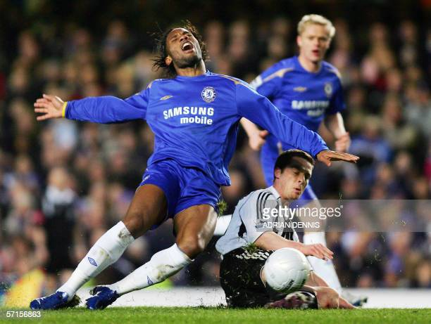 Chelsea's French forward Didier Drogba reacts after a tackle from Newcastle United's Scott Parker during their FA Cup quarterfinal football match at...