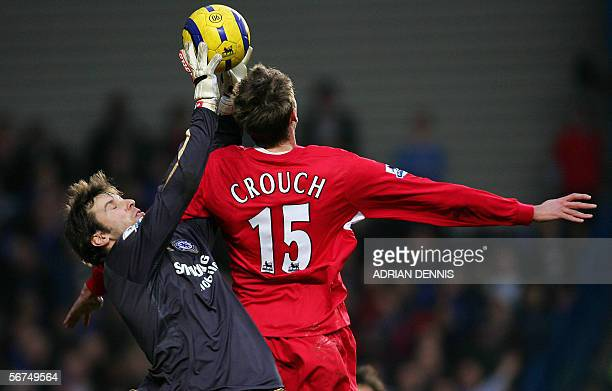 Chelsea's goalkeeper Petr Cech takes the ball off the head of Peter Crouch of Liverpool during the Premiership football match at Stamford Bridge in...