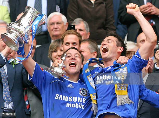 Chelsea's John Terry and Frank Lampard celebrate with the FA Cup after beating Manchester United 10 at Wembley Stadium in London 19 May 2007 during...