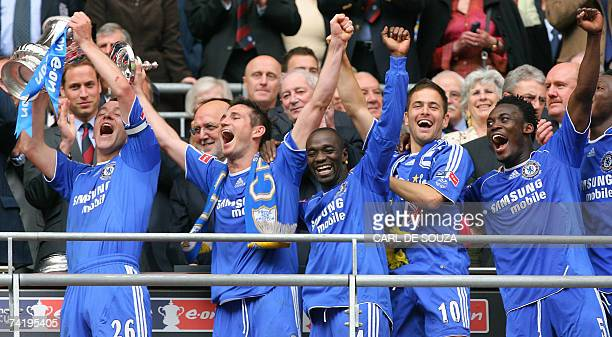 Chelsea's John Terry Frank Lampard Claude Makelele Joe Cole Michael Essien and John Obi Mikel celebrate with the FA Cup Trophy after beating...