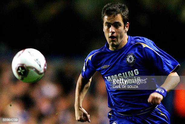 London, UNITED KINGDOM: Chelsea's midfielder Joe Cole eyes the ball during the Champions League Group G football match against Real Betis at Stamford...