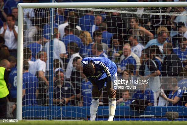 London, UNITED KINGDOM: Chelsea's Nigerian midfielder Jon Obi Mikel leans as his side draw 2-2 in the English Premiership match between Chelsea and...