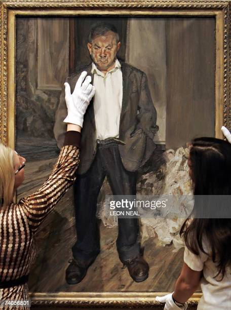 """London, UNITED KINGDOM: Christie's auction house members of staff hold the painting """"Bruce Bernard"""" by Lucian Freud as it goes on display in London,..."""