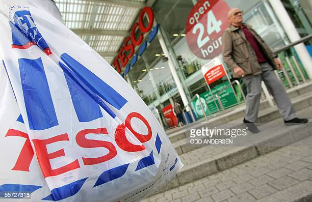 Customers leave a Tesco supermarket in west London 20 September 2005 Tesco the biggest British supermarket chain posted an 187 percent increase in...