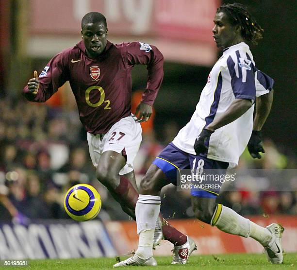 Emmanuel Eboue of Arsenal vies for the ball with Aliou Cisse of Portsmouth in a premiership match at Highbury in north London 28 December 2005...