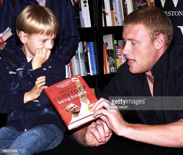 England cricket bowler Andrew Flintoff right talks with his fan Emile Hudd 5 during a book signing by Andrew Flintoff of his new book Being Freddie...