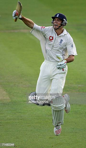 England's Alastair Cook reacts as he runs down the wicket to score his century against Pakistan during the first test match at Lord's in London 13...
