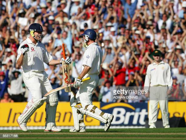 England's Andrew Flintoff runs in to celebrate with Andrew Strauss after he hit a boundary to score his century against Australia during the first...