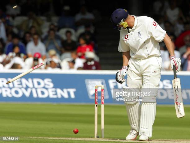 England's Andrew Flintoff watches his off stump fly through the air from the bowling of Australia's Glenn McGrath on the first day of the first Test...