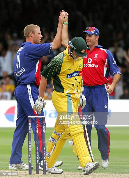 England's bowler Andrew Flintoff and Michael Vaughn celebrate Flintoff's dismissal of Australia's Brett Lee 02 July 2005 in the final of the Natwest...
