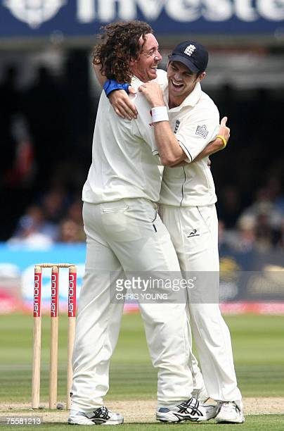 London, UNITED KINGDOM: England's bowler Ryan Sidebottom celebrates with James Anderson after taking the wicket of India's V.S Laxman during the...