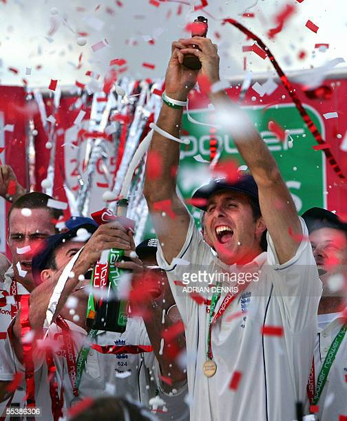 England's Captain Michael Vaughan celebrates with the replica of Ashes trophy after defeating Australia in The Ashes in the fifth Test Match in The...