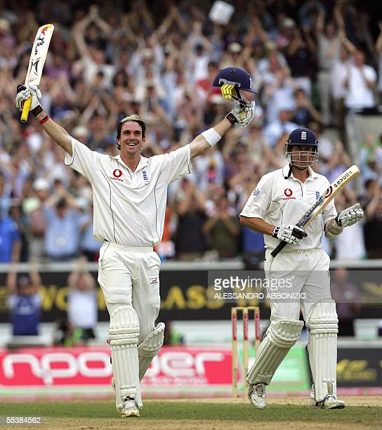 England's Kevin Pietersen celebrates his first Test century as teammate Ashley Giles applauds as he bats against Australia on the fifth day of the...