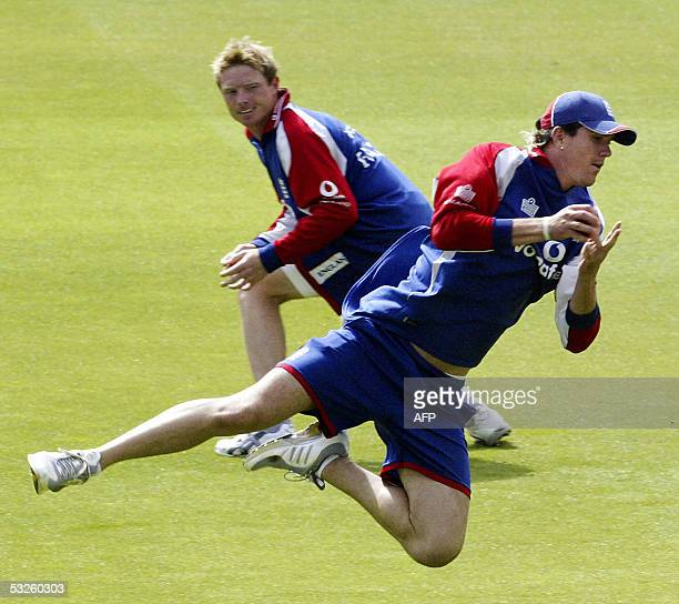 London, UNITED KINGDOM: Englands Kevin Pietersen dives for a catch as Ian Bell looks on at Lords cricket ground in London as the English team train,...